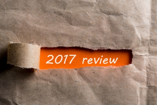 2018 review uncovered envelope of brown paper with letter. The concept of achievements and failures of career and business at the Year.